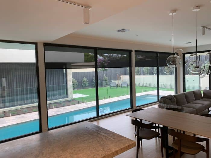 Automated blinds overlooking pool in Melbourne luxury homee