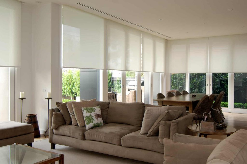 Translucent motorised roller blinds in recessed pelmet in living room in Hawthorn renovation