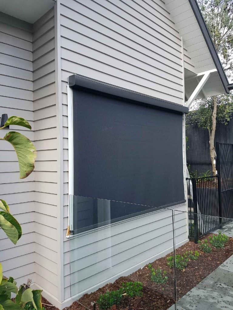 Closed motorised External Blind on weatherboard house