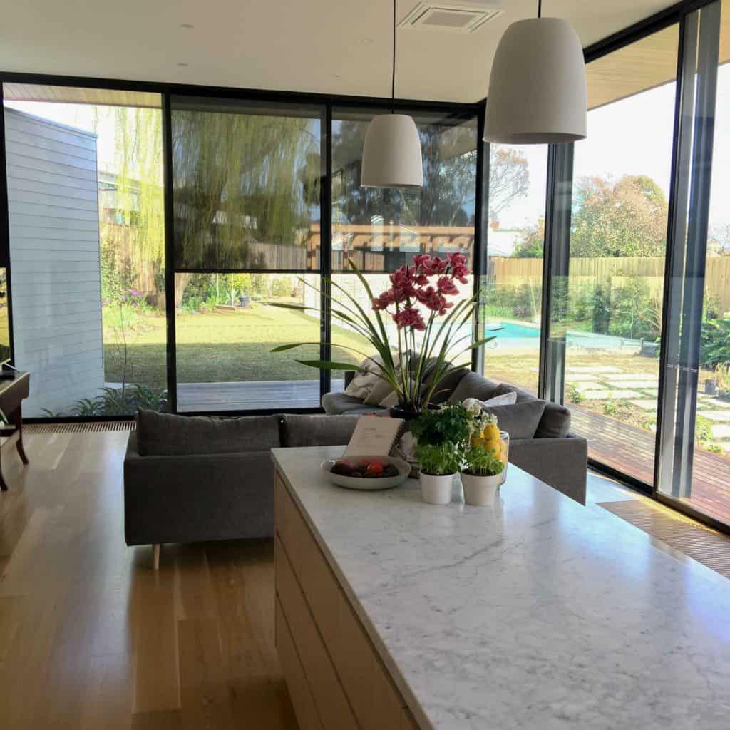Glare reducing sunscreen motorised blinds in livingroom by SOM Blinds