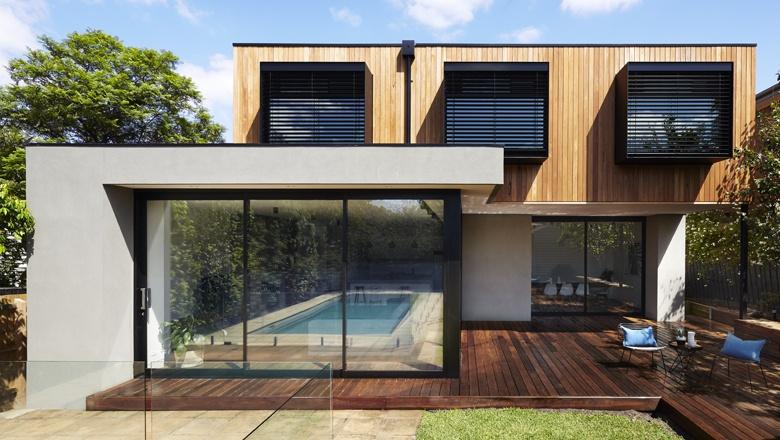 Energy efficient home design using external venetians in black steel shrouds