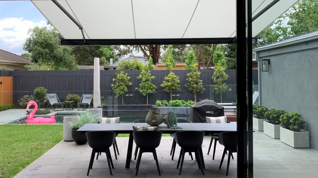 markilux folding arm awning providing shading to outdoor entertainment area - energy efficient home design providing shade in summer and access to winter sun